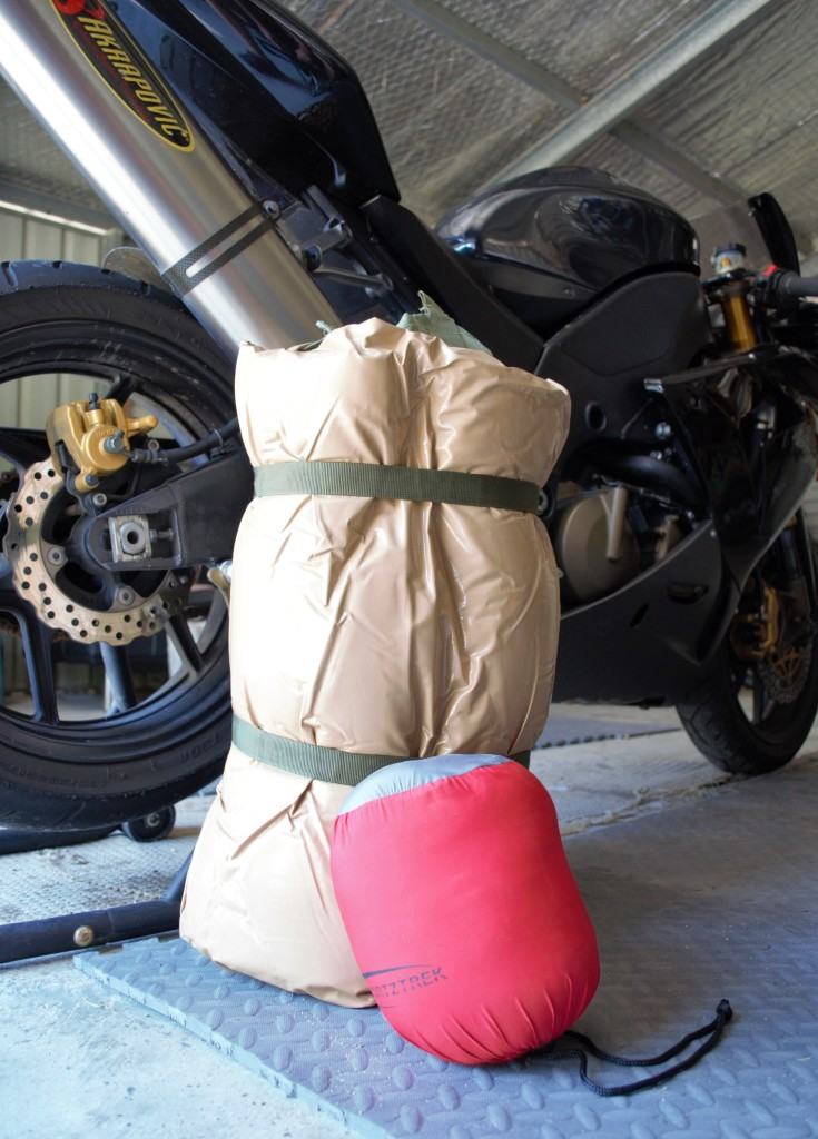 Biker swag and expandable pillow. The biker swag is very nearly half the size of a king single.